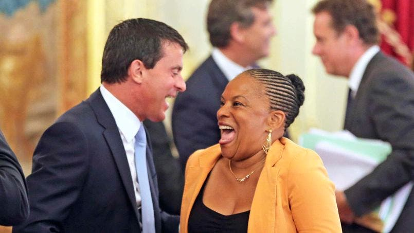 French Interior Minister Valls laughs with French Justice Minister Taubira as they attend a government seminar at the Elysee Palace in Paris