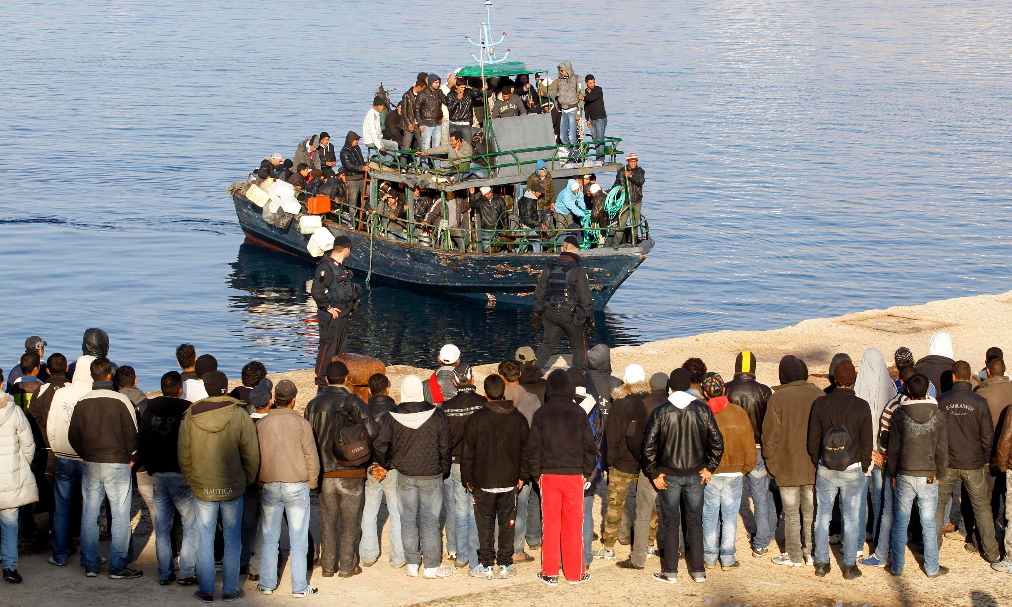 File picture showing migrants from North Africa arriving at Lampedusa