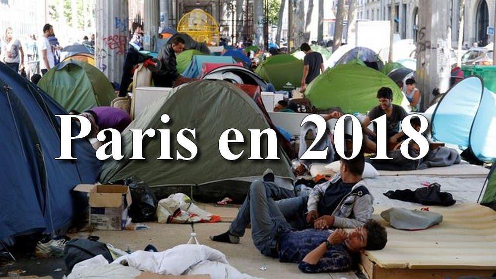 des-migrants-installes-dans-leurs-tentes-dans-un-campement-illegal-sous-le-metro-de-la-station-jaures-a-paris-le-19-juillet-201